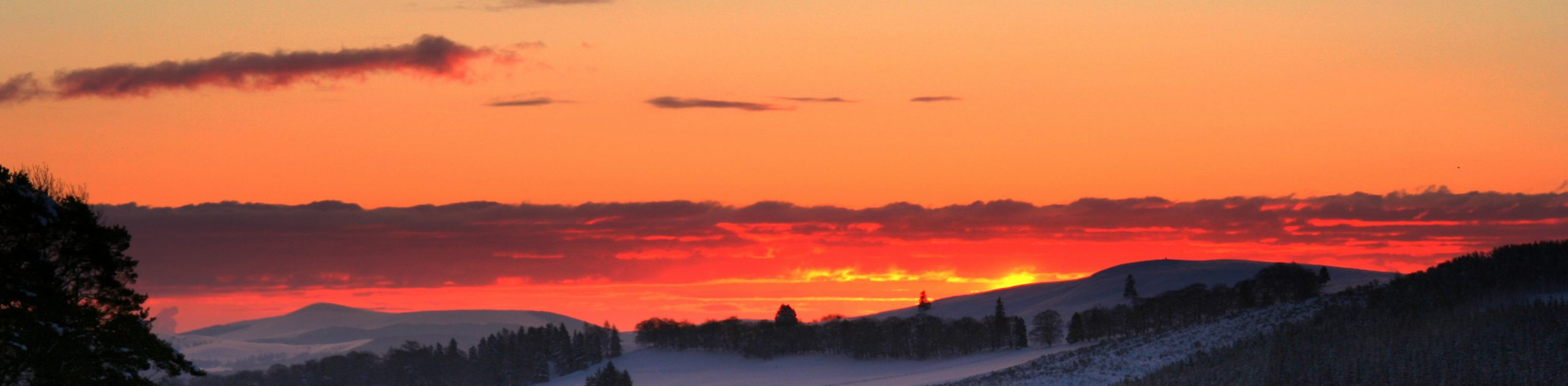 banner red sunrise snow